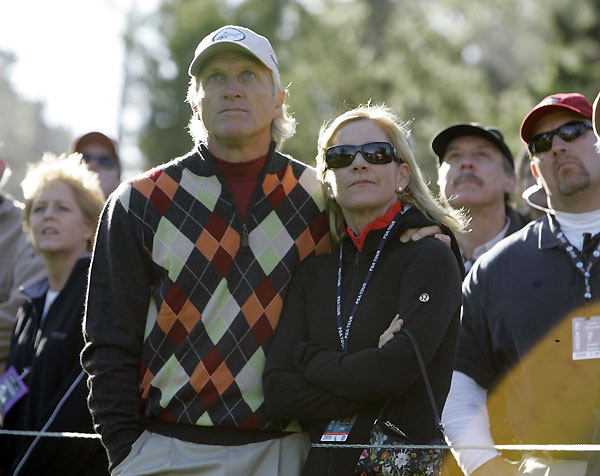 Greg Norman and his fiancee Chris Evert watched Norman's son Gregory hit from the 12th tee at Spyglass Hill Golf Course.