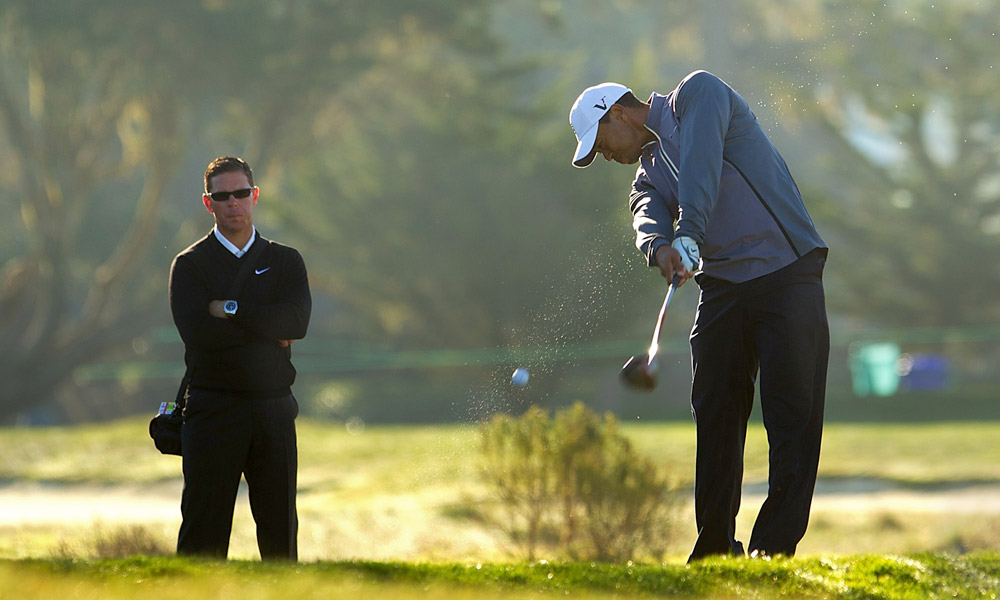 Swing coach Sean Foley joined Tiger for his round.