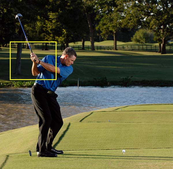 Step 2 Take the clubhead back low to the ground and slightly inside your target line. Fight the urge to lift your arms and hands. You should feel like you're swinging the clubhead around your body, with your hands staying even with or just below your right shoulder.
