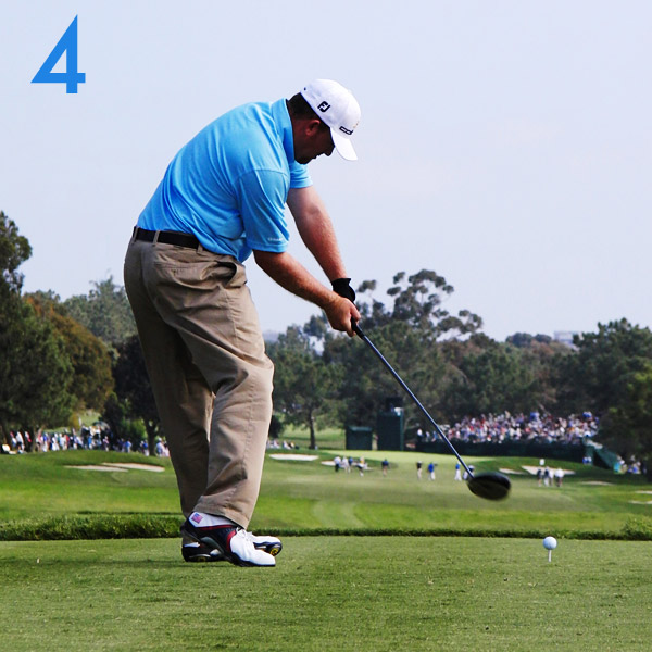 4. Holmes' downswing squat and wrist hinge make up for his unorthodox address and top positions — he slots the club perfectly and enters the hitting zone with the shaft at a perfect 45-degree angle. Notice the sequence thus far: Legs, hips, and shoulders. The hands are up next.