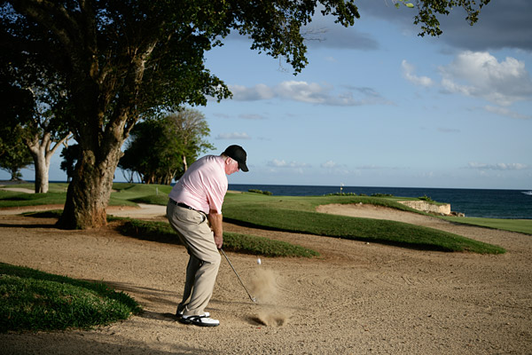 How To Punch One from a Fairway Bunker                           Sometimes it's easier to                           roll the ball to the green                           than to fly it there                           By Rod Lidenberg                           Top 100 Teacher                                                      This story is for you if...                           • Your main goal in a                           fairway bunker is to                           escape — you don't think                           about hitting the green.                           • You tend to hit behind                           the ball in fairway sand                           and leave the shot short.                                                      The Situation                           You're in a fairway                           bunker, but close enough                           to the green that a full                           swing with a short iron                           would come out too hot                           and roll off the green.                           The Solution                           If the front of the green                           is clear of obstacles, play                           a punch shot that lands                           short of the green and                           works its way on.                                                      How To Punch It On From Sand                           Since all you're looking to                           do is to punch the ball, your                           finish is of little consequence.                           Focus on the backswing and                           impact cues below.                                                      Step 1                           Choose a 6-, 7- or 8-iron,                           depending on your distance to                           the pin. With a 6-iron, a bunker                           punch will give you 100 yards                           of carry and 50 yards of roll.                           The ball will fly low and run                           out onto the green.
