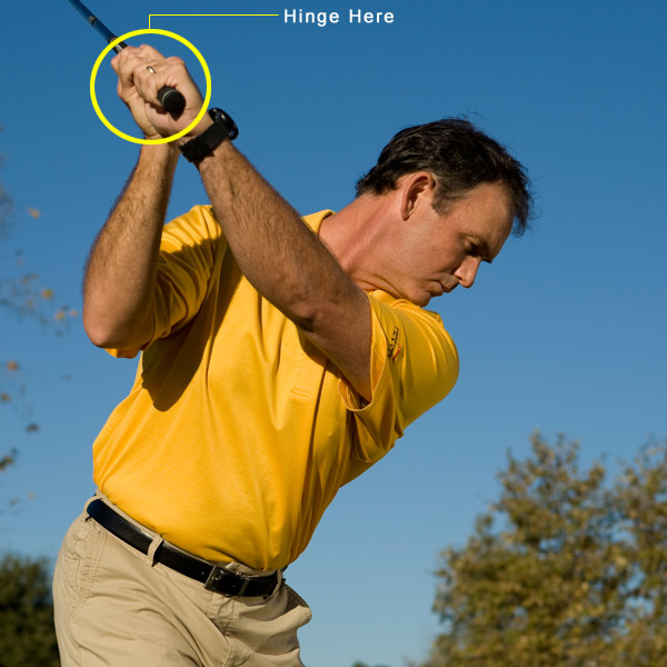 How To Compress the Ball for Power                             Hinging and                             holding your right                             wrist gives you                             distance and spin                             By Dave Phillips                             Top 100 Teacher                             This story is for you if...                             • Your impact feels mushy.                             • You can't get your short                             and mid-irons to spin.                             • You're a club shorter                             than your buddies.                                                          The Problem                             You tend to pick the ball off the                             grass, which allows you to hit                             decent shots, but you never get                             the feeling of true compression                             and the ball often falls short of                             your target.                             The Solution                             The only way to generate                             powerful iron shots is to hit                             down on the back of the ball                             and then drive your clubhead                             through the dirt. While many                             moves are required to do this on                             a consistent basis, you can take                             a giant step forward by focusing                             on the action of your right wrist.                             Follow the steps at right.                                                                                       Step 1: HINGE & SUPPORT                             As you swing the club                             to the top, hinge your                             wrists so that you                             create a noticeable                             angle between your                             right forearm and your                             right wrist. If you do                             it correctly, the back                             of your left wrist will                             be flat and you'll feel                             like your right hand                             is under the club,                             supporting it rather                             than directing it. This                             right-wrist hinge is an                             important power lever                             in your swing — without                             it, your swing loses                             the ability to whip                             the clubhead through                             the ball at the fastest                             possible speed.