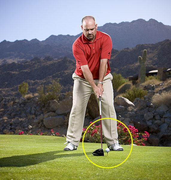 Step 1                       Tee the ball slightly lower-set it so that all of the ball is below the crown. This will help you produce a lower trajectory and keep the ball from ballooning into trouble.