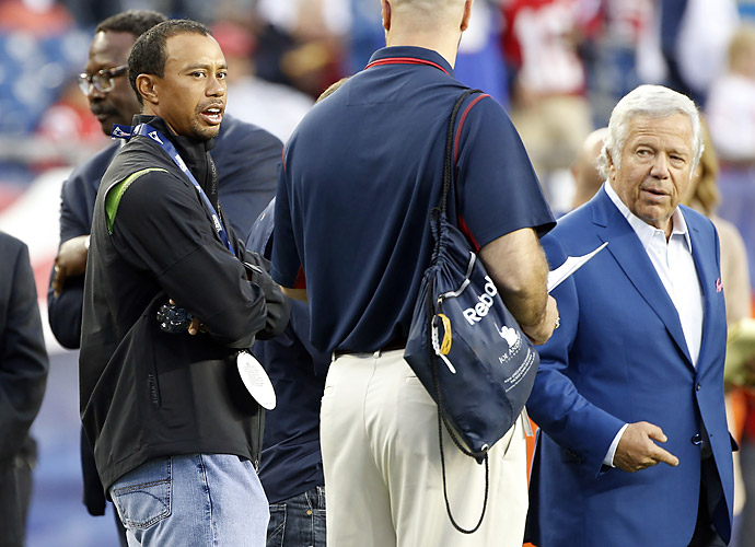 Tiger Woods is a huge football fan and frequently attends games. Earlier this year, he was on the sideline with New England Patriots owner Robert Kraft (far right) to watch the Pats face the New York Giants in a preseason matchup.