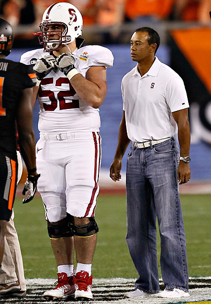 A Stanford alum, Woods can often be found on the field with his alma mater's team, as he was here before the 2012 Fiesta Bowl.