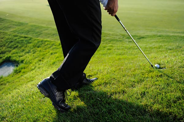 STEP 3                                                      Feel like you're moving the club up the hill going back and then down the hill coming through — you should finish low and with little follow-through. Basically, you're trying to trace the hill with your clubhead.