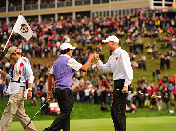won the 18th hole to halve their match with Lee Westwood and Martin Kaymer.