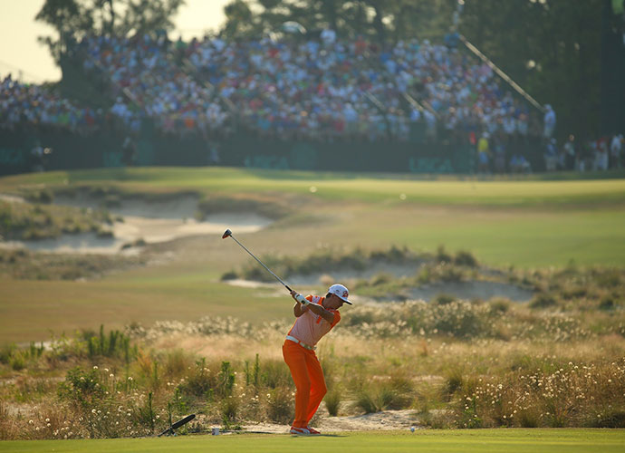 Fowler tees off on the 13th hole. His T2 finish is a career-best in a major for the 25-year-old.