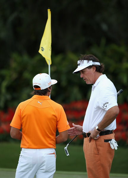 Phil Mickelson gave Rickie Fowler a few putting tips during their practice round.