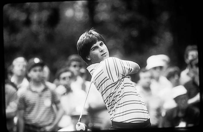 A young Fred Couples tees off during the Masters Tournament in the 1980s (date unknown).