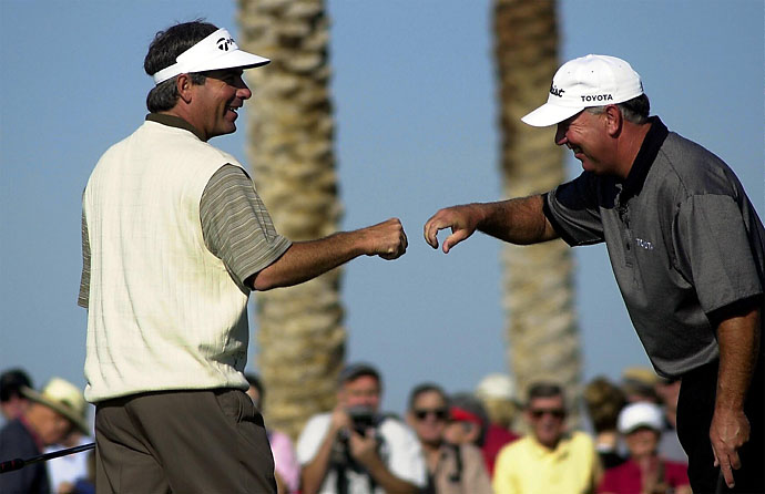 White men CAN fist bump! Fred Couples is congratulated by Mark O'Meara after Couples won a skin, for $50,000, on the 11th hole on Dec. 1, 2002, during the Skins Game at the Landmark Golf Club in Indio, Calif.