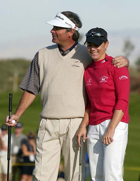 Annika Sorenstam  gets a hug from Fred Couples after she won a skin on the 10th hole at the Skins Game in La Quinta, Calif., in November 2003.