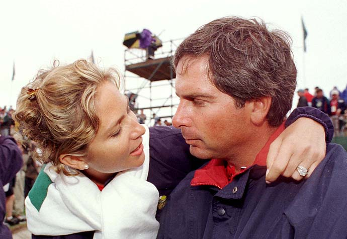Fred Couples on right is consoled by his wife, Thais, after the Americans lost the Presidents Cup to the International team during the final day singles matches at Royal Melbourne Golf Course in Australia, on Dec. 13, 1998.