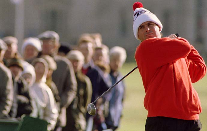 Fred Couples has a captive audience as he tees off on the second at St Andrews at the Arthur Dunhill Cup in October 1994.