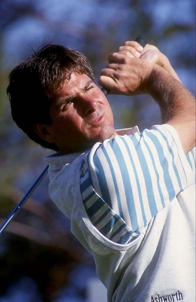 Fred Couples watches his shot during the 1991 Shark Shootout at the Sherwood Country Club in Thousand Oaks, Calif., in November 1991.