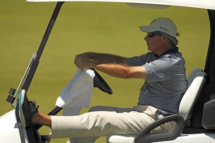No socks, no problem. Fred Couples, a golf style icon, rides in a golf cart with street-style golf shoe at the Champions Tour Cap Cana Championship in the Dominican Republic in March 2010.