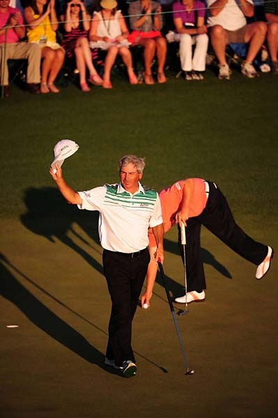 Fred Couples acknowledges the crowd on Saturday at the 2012 Masters. Couples finished T12 at the tournament.