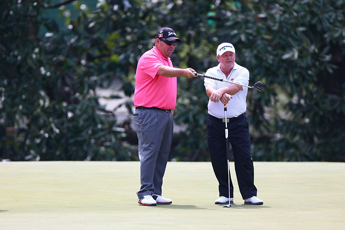 Kevin Stadler taks with 1991 Masters champion Ian Woosnam on the fifth green Friday.