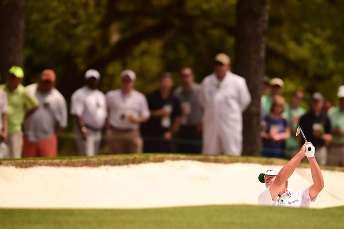 Steve Stricker buried in an Augusta National fairway bunker on the first hole Friday.