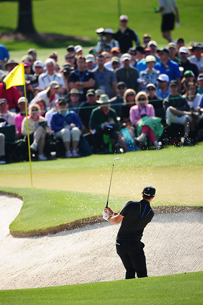 Dustin Johnson plays a bunker shot at Augusta National on Friday.