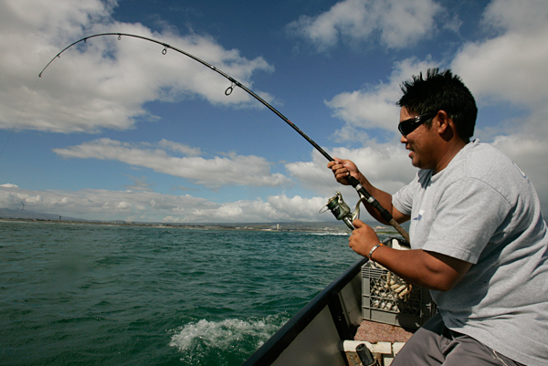 Behind the Scenes with Tadd Fujikawa                                              This gallery first ran with Alan Shipnuck's profile of Fujikawa in December 2007.                                              Tadd Fujikawa and his father, Derrick, went fishing in the waters off Sand Island in Honolulu, where Derrick has been a regular since he was a boy fishing with his dad.