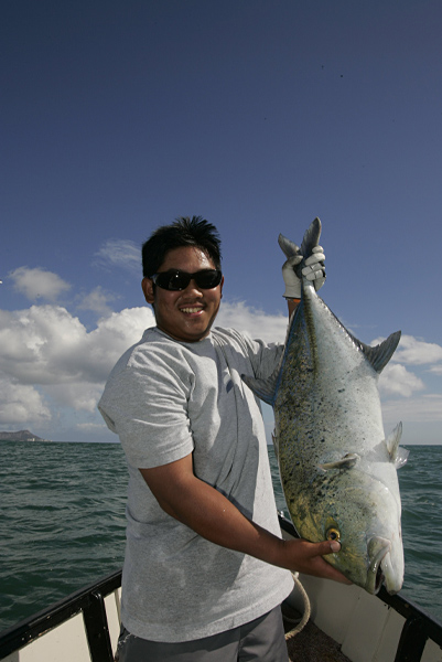After a heroic battle that lasted at least 10 minutes, Fujikawa reeled in a 17-pound ulua that was so big it wouldn't fit in the ice chest.