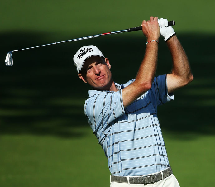 Jim Furyk also shot a 65 and is tied with Scott for the lead.