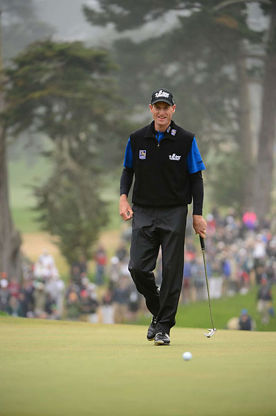 Triple Play                           Jim Furyk wore the vested short-sleeve style, but with a compression jersey beneath, for a black-blue-black triple layer look.