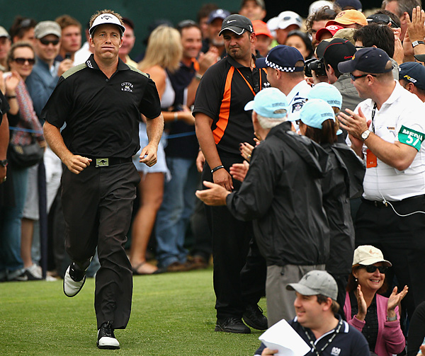 Appleby almost missed the trophy presentation. Only when he heard his name over the speakers did he make a dash under the grandstands and onto the 18th green.