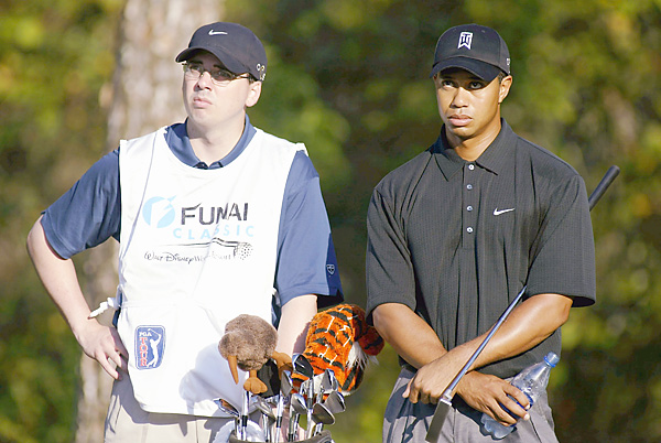 Tiger Woods's childhood friend Byron Bell has occasionally stepped in as a caddie, including here at the 2003 Funai Classic.
