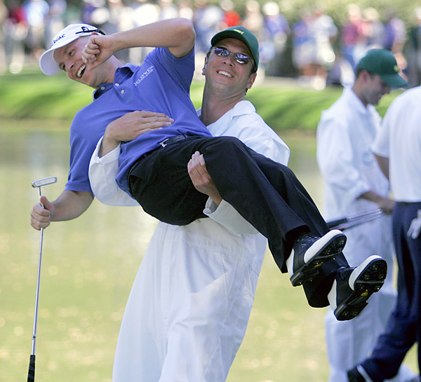Drew Bledsoe grabbed Ben Crane's bag, and Crane, at the 2006 Par 3 Contest.