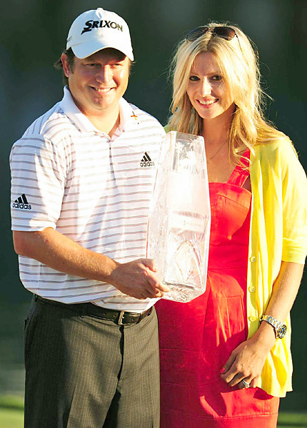Clark celebrated his first tour win with his wife, Candace.