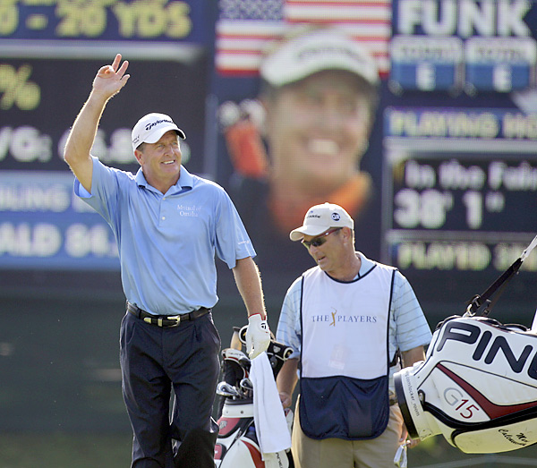 won the 2005 Players Championship, and saluted the crowd after a birdie on the 11th hole.