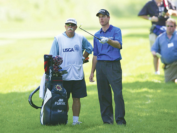 Jim Furyk and Mike Cowan                           Jim Furyk won the 2003 U.S. Open (shown here) with Mike Cowan, who started working for Furyk almost immediately after his stint with Woods. Fluff first made a name for himself caddying for funnyman Peter Jacobson.