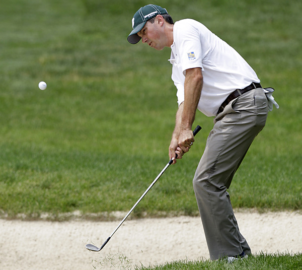 Matt Kuchar shot a 65 to finish one stroke back.