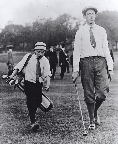 Francis Ouimet and Eddie Lowery                           Only one player-caddie image has ever made it to a U.S. stamp: tiny, 10-year-old Eddie Lowery caddying for teenager Francis Ouimet in his 1913 U.S. Open win at The Country Club in Brookline, Mass.