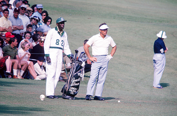 Arnold Palmer and Iron Man Avery                           Before 1983, Augusta National required players to use club caddies, and Arnold Palmer had tremendous success with Iron Man Avery (shown here at the 1965 Masters).