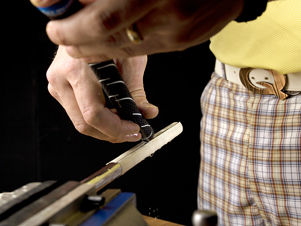 Step 13 Pour the excess solvent out of the grip and onto the tape.