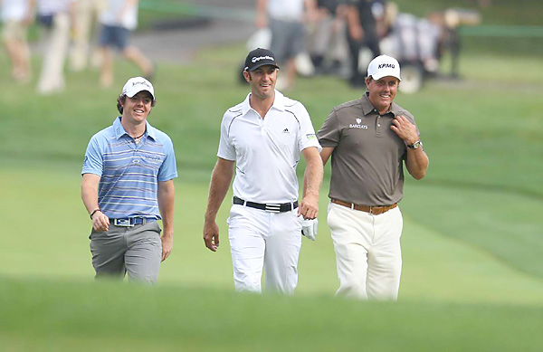 McIlroy and Mickelson played with Dustin Johnson the first two rounds.