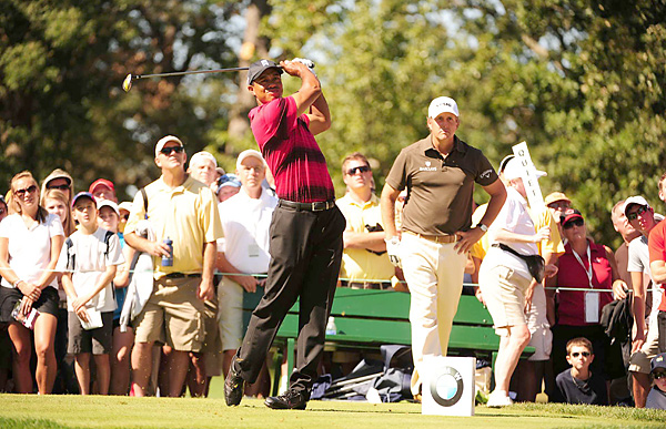 Woods made three bogeys on the front nine before making four late birdies to finish with a one-under 70.