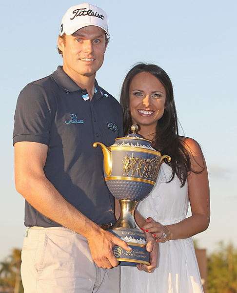 Amber Watney                                                          Amber celebrated with her husband, Nick, after his win at the 2011 WGC-Cadillac Championship at Doral.