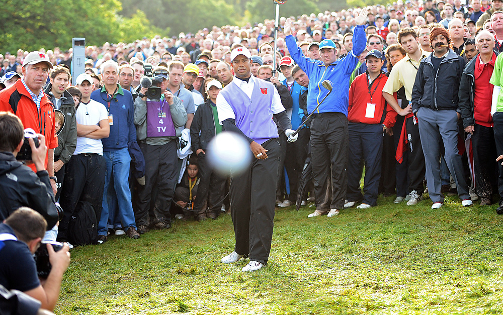 "Cigar Guy At 2010 Ryder Cup, Woods shanked this chip shot, but made a celebrity out of the fan in the background dressed as Miguel Angel Jimenez (far right), who became known as ""Cigar Guy."""
