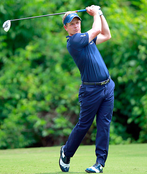 Luke Donald will take over the No. 1 ranking from Rory McIlroy after shooting a 67 to finish alone in third place.