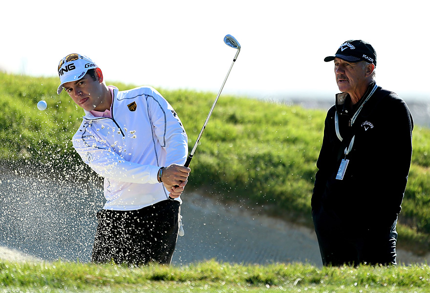 Louis Oosthuizen practiced under the watchful eye of his coach, Pete Cowan.