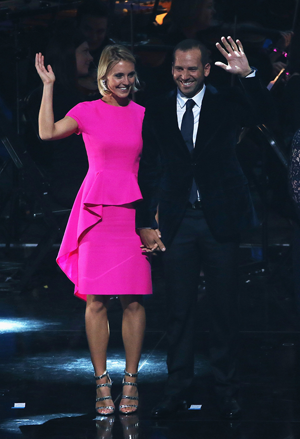 Sergio Garcia of Europe and Katharina Boehm wave during the 2014 Ryder Cup Gala Concert at the SSE Hydro on Sept. 24, 2014, in Glasgow, Scotland.