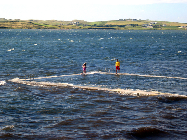 After a round of golf at Carne, you can always go for a dip in Belmullet's municipal pool. Here, a couple of local kids dip their toes in Blacksod Bay. My great-grandfather and great-grandmother (and thousands of others) set sail for America from a spot just across the bay. (Recommended listening: 'American Wake' by The Elders, from their album of the same name.)