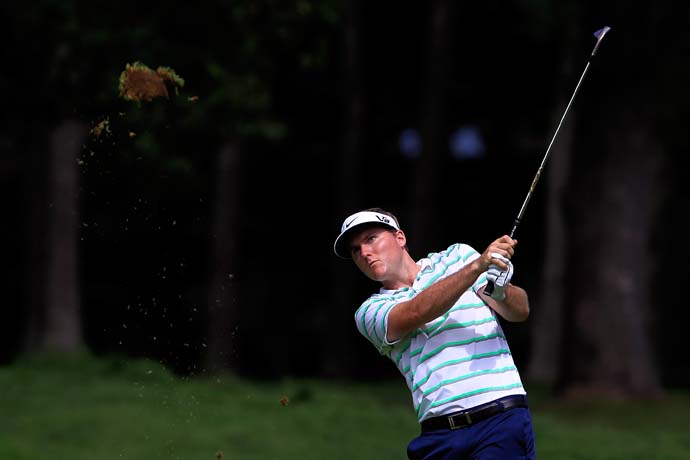 A true boy of summer, Russell Henley is 8-under after two rounds.
