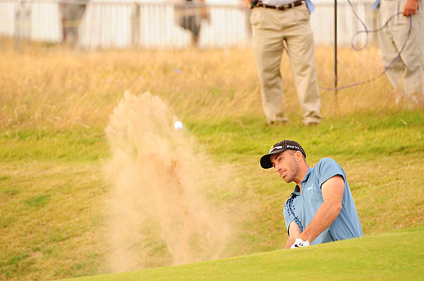 Geoff Ogilvy found himself in a tight spot in this bunker. He stumbled to a five-over 75 for the day.