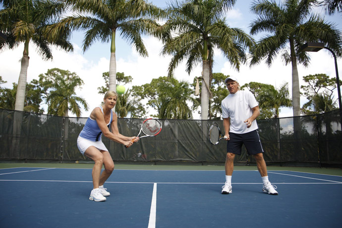 Chris Evert and Greg Norman play tennis on a court at Evert's home in January 2009 during their 15-month marriage.