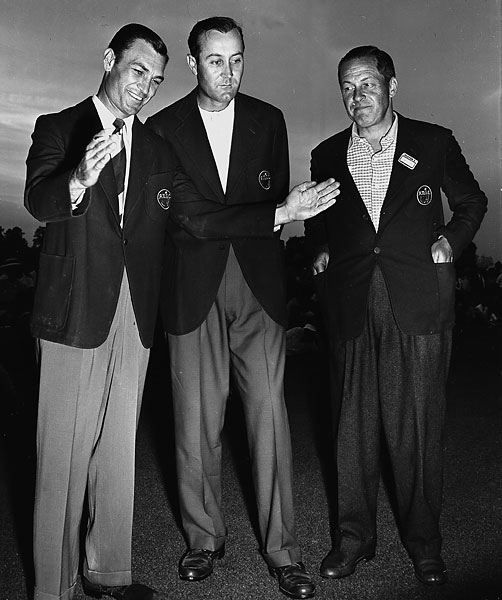 "Ben Hogan: 1946 Masters                           In his first post-war Masters, Hogan trailed unheralded Herman Keiser by one. Hogan hit his approach onto the 18th green, 12 feet above the hole. (Hogan's own account, quoted in Curt Sampson's ""Hogan"" book, said 15 feet, but most accounts said 12.) If he made it he would win. Hogan gently tapped the putt and missed. Hogan claimed it rolled four feet by, but three other accounts have it listed at 2 and 2 1/2 feet. Hogan missed the comebacker as well, with one account stating it didn't touch the hole. In this photo, Hogan shows Keiser [middle] and Bobby Jones [right] how short his putt was."